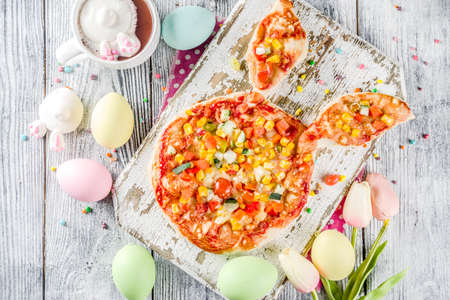 Photo for Funny easter food, ideas recipes for children Easter party, healthy  kids pizza with vegetables, top view copy space - Royalty Free Image