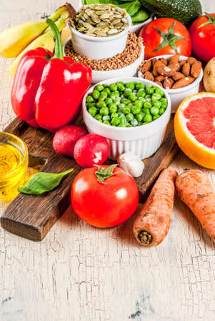 Foto per Healthy food background, trendy Alkaline diet products - fruits, vegetables, cereals, nuts. oils, light concrete background  copy space - Immagine Royalty Free