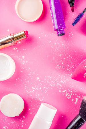 Various make up cosmetic set bright pink background copy space flatlay aboveの写真素材