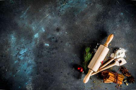 Photo pour Christmas bakery background, with baking utensils, flour, spices and decorations, dark concrete table, copy space top view - image libre de droit
