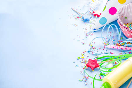 Sweet baking concept for birthday holiday party, cooking background with baking stuff - rolling pin, whipping whisk, cookie cutters, sugar sprinkling, flour. Light blue background, above copy space