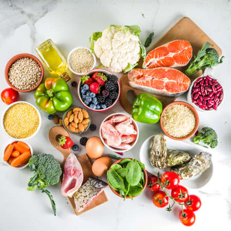 Photo for Pescetarian diet plan ingredients, healthy balanced grocery food, fresh fruit, berries, fish and shellfish clams, white marble background copy space - Royalty Free Image