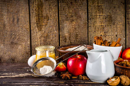 Photo pour Autumn baking concept. Cooking baking background with ingredients, spices and utensils. All you need for baking traditional autumn apple pie, on rustic wooden background copy space - image libre de droit