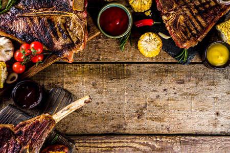 Photo pour Set of various grilled meat, different beef steaks with sauces.Bbq beef steaks - chateau mignon, t-bone, tomahawk, striploin, tenderloin, new york steak. Wooden rustic background - image libre de droit