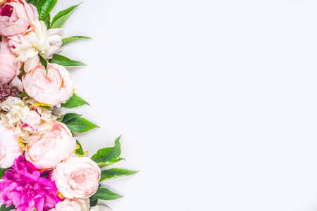 Photo for Flat lay of flowers and green leaves. Tender Peonies and chrysanthemums bloom pattern, composition for postcards on white background. - Royalty Free Image