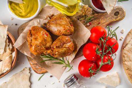 Photo pour Roasted chicken legs or wings. Grill roasted spicy legs or wings, with various sauces and spices, copy space - image libre de droit