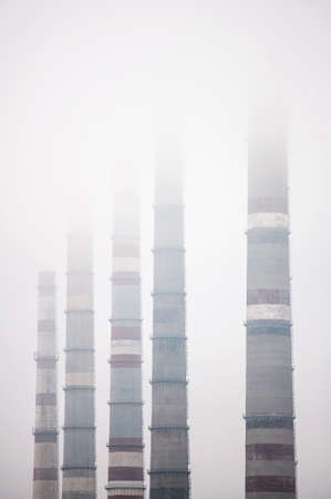 Air pollution by smoke coming out of  factory chimneys