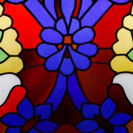 Foto de Detail of a stained glass window, bright colors, shot close-up. - Imagen libre de derechos