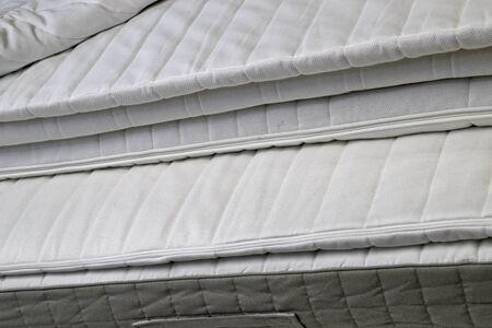 Photo pour Folded white new bed mattresses filmed close-up - image libre de droit