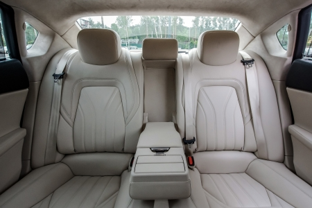 Ivory color luxury town car passengers interior.