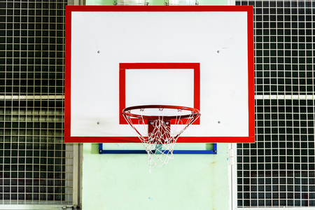 Closeup of basketball hoop in school sport hall