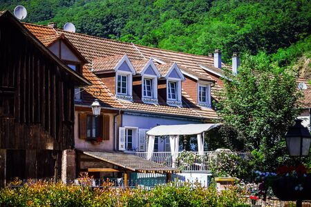 Typical alsacien house in small village, Bas-Rhin, France. Tourism and travel concept.