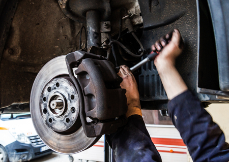 Photo pour Tire replacement service, fitting with balancing, change to summer - image libre de droit