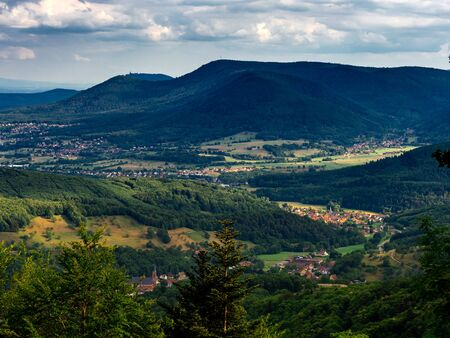 Spacious mountain landscape. A view from the mountain to the valley of Rhine and the village of Alsace. France.