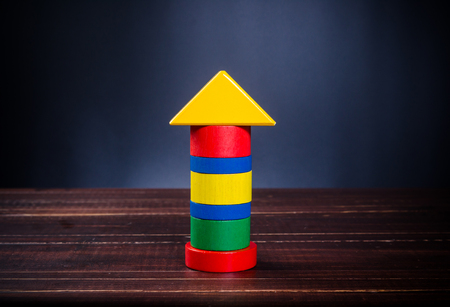Concept of growth in business,stack of wooden block,bar graph