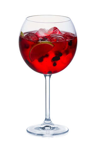 Photo pour Blackberry cocktail with a sparkling wine, lime and ice cubes in round wine glass isolated on white - image libre de droit