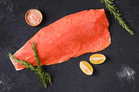 Photo pour Raw frozen salmon fillet on dark background - image libre de droit