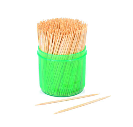 Toothpicks in a green box isolated on a white