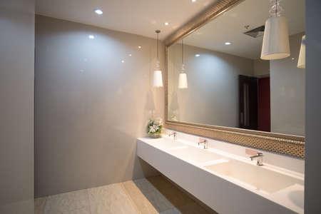 Photo pour public empty restroom with washstands mirror,public toilet - image libre de droit