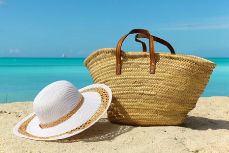 beach holiday background with white sand bag and hat