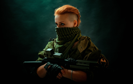 Photo pour Young woman with red hair in military green uniform - image libre de droit