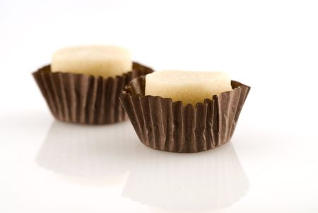 Two marzipan candy with selective focus on white background