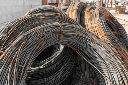Photo pour Thin metal reinforcement wound into bays at the metal products warehouse. - image libre de droit