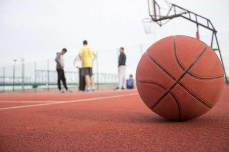 Young group of man making break during playing basketballの写真素材