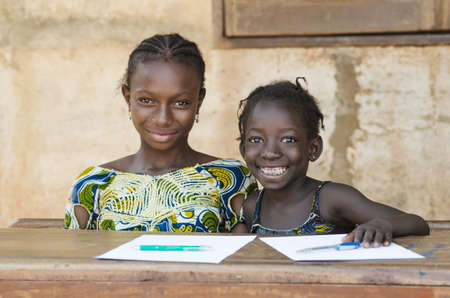 Photo pour Two African Ethnicity Children Smiling Studying in a School Environment (Schooling Education Symbol) - image libre de droit