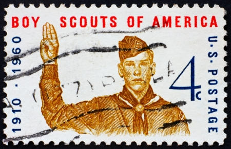 UNITED STATES OF AMERICA - CIRCA 1960: a stamp printed in the United States of America shows Boy scout giving scout sign, 50th anniversary of Boy scouts of America, circa 1960
