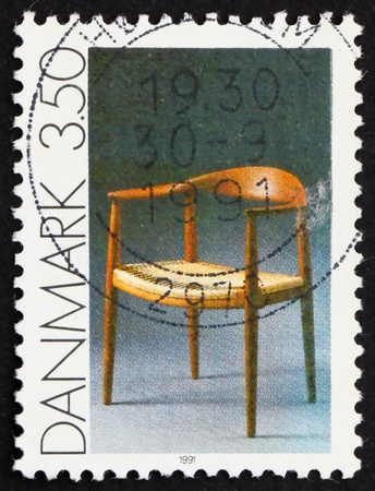 DENMARK - CIRCA 1991: a stamp printed in the Denmark shows Chair by Hans Wegner, Modern Design, circa 1991