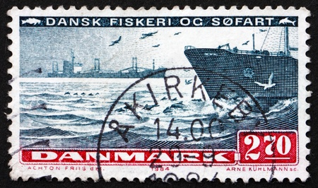 DENMARK - CIRCA 1984: a stamp printed in the Denmark shows Ships on Sea, Sea Transport, Fishing and Shipping, circa 1984
