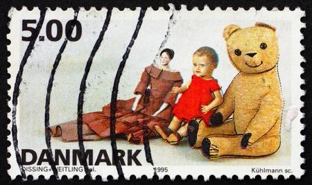 DENMARK - CIRCA 1995: a stamp printed in the Denmark shows Dolls and Teddy bear, Toys, circa 1995