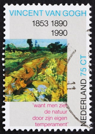 NETHERLANDS - CIRCA 1990: a stamp printed in the Netherlands shows The Green Vineyard, Detail of Painting by Vincent van Gogh, circa 1990