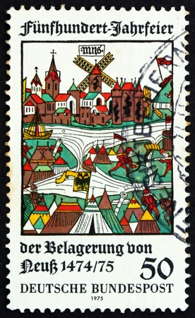 GERMANY - CIRCA 1975: a stamp printed in the Germany shows View of Neuss, Woodcut, 500th Anniversary of Unsuccessful Siege of Neuss by Duke Charles, Bold of Burgundy, circa 1975