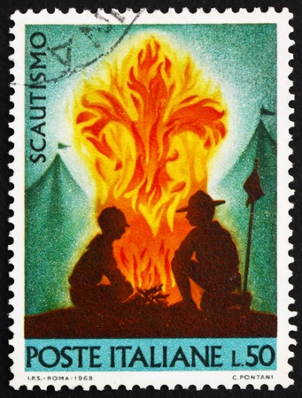 ITALY - CIRCA 1968: a stamp printed in the Italy shows Scouts at Campfire, circa 1968
