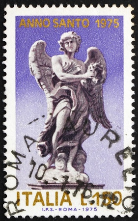 ITALY - CIRCA 1975: a stamp printed in the Italy shows Angel holding Crown of of Thorns, Statue by Giovanni Bernini on the Angels' Bridge, San Angelo, circa 1975