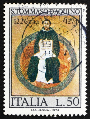 ITALY - CIRCA 1974: a stamp printed in the Italy shows St. Thomas Aquinas, by Francesco Traini, Scholastic Philosopher, 700th Death Anniversary, circa 1974