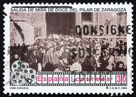 SPAIN - CIRCA 1996: a stamp printed in the Spain shows Scene from First Spanish Motion Picture, Salida de los Fieles del Pilar de Zaragoza, circa 1996