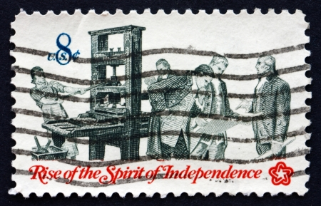 UNITED STATES OF AMERICA - CIRCA 1973: a stamp printed in the USA shows Printer and Patriots Examining Pamphlet, Communications in Colonial Times, American Bicentennial, circa 1973