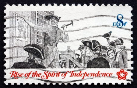 UNITED STATES OF AMERICA - CIRCA 1973: a stamp printed in the USA shows Posting a Broadside, Communications in Colonial Times, American Bicentennial, circa 1973