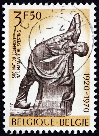 BELGIUM - CIRCA 1970: a stamp printed in the Belgium shows The Mason, Sculpture by Georges Minne, 50th Anniversary of the National Housing Society, circa 1970
