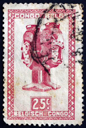 BELGIAN CONGO - CIRCA 1948: a stamp printed in Belgian Congo shows Mbuta, sacred double cup, carved with two faces, man and woman, Baluba tribe, circa 1948