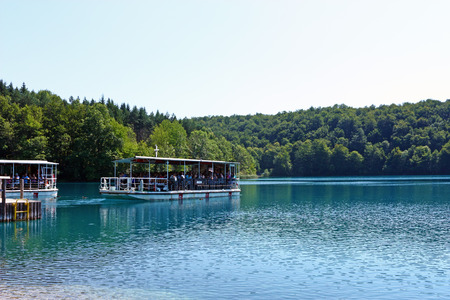 CROATIA PLITVICE, 16 JULY 2011: Beautiful lake with river boats on the blue water