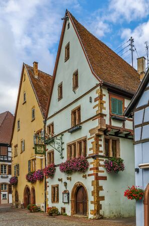 Picturesque historical street in Eguisheim, Alsace, France