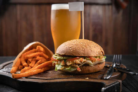 Photo pour American hamburger with crab and french fries meat on wooden board - image libre de droit