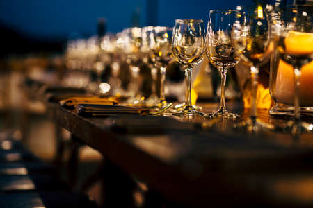 Photo pour Luxury table settings for fine dining with and glassware, beautiful blurred  background. Preparation for holiday  Christmas and Hannukah dinner night. - image libre de droit