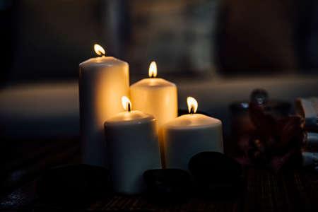 Foto de Romantic candle in beautiful dark evening light for events. Luxury events or weddings. Design element.  Candles, romance, love, hope, relaxation, - Imagen libre de derechos
