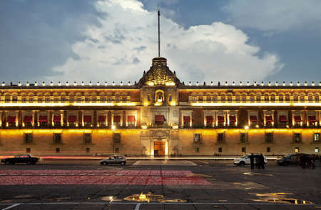 Illuminated National Palace in Plaza de la Constitucion of Mexico City at sunset  Zocalo and Army Square are among other local names of this place