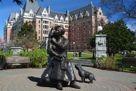 Empress Hotel and an Emily Carr statue in Victoria BC,Canada